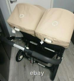 Bugaboo Donkey twin in sand with double maxi Cosi car seat adapter