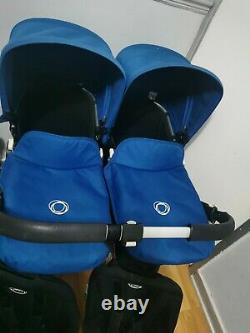 Bugaboo Donkey Twin En Bleu Avec Des Sièges Maxi Cosi